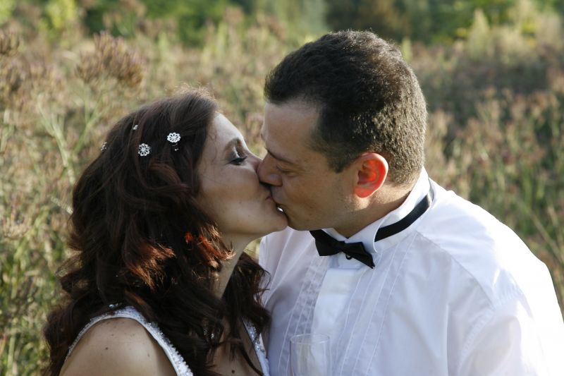 bride and groom kissing at Valverde