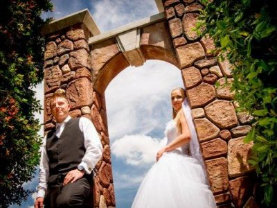 Valverde stone arch with bridal couple