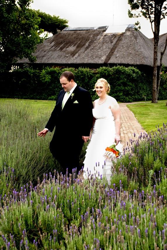 Wedding couple in lavender field at Valverde