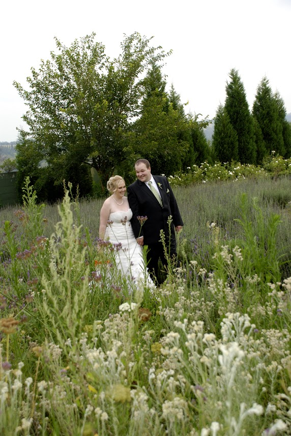Wedding couple walking in the field at Valverde
