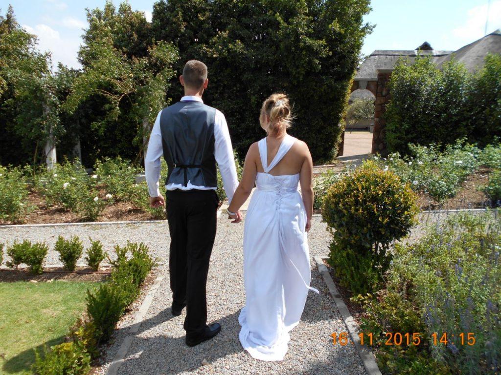 Wedding couple walking at Valverde