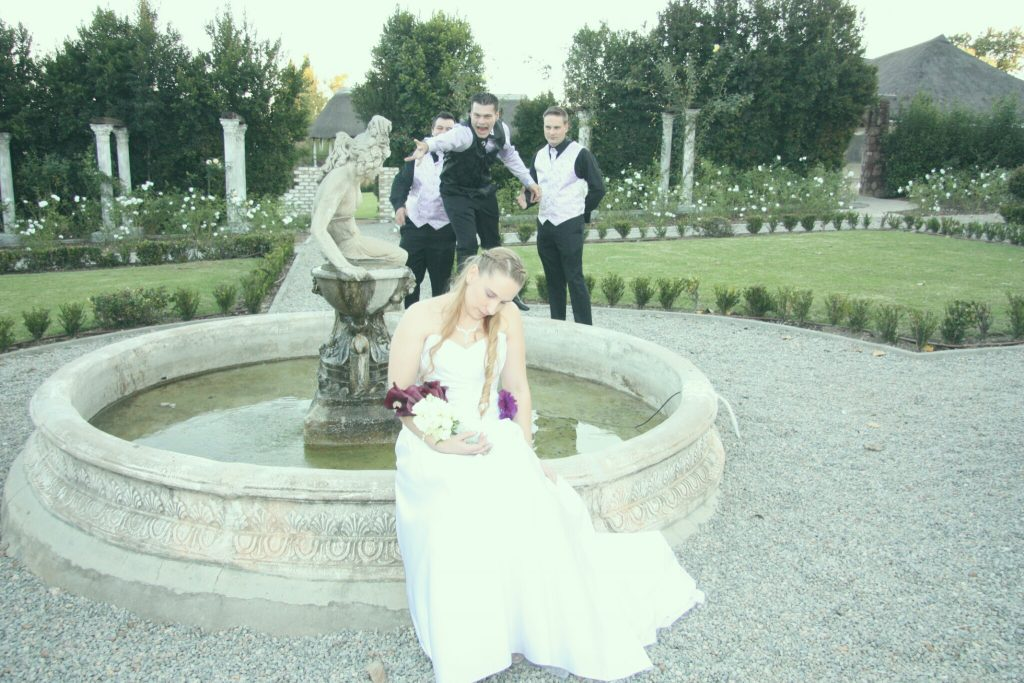 Valverde wedding couplea at formal garden fountain