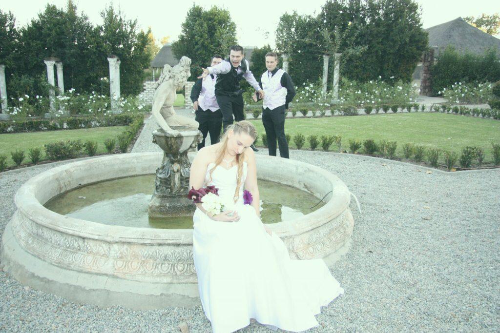 Valverde wedding couplea at formal garden fountain